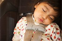 Close-up of toddler girl sleeping in child safety seat, USA Stock Photo - Premium Rights-Managednull, Code: 700-07311592