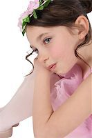 Brunette ballet girl against a white background wearing pink Stock Photo - Royalty-Freenull, Code: 400-07313959