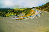 road landscape - Bend in the road in the mountains in the fog Stock Photo - Royalty-Freenull, Code: 400-07314431