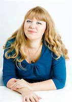portrait of a young blonde woman with overweight Stock Photo - Royalty-Freenull, Code: 400-07318073