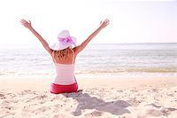 a girl wearing hat on the beach Stock Photo - Royalty-Freenull, Code: 400-07327992