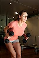 Young Woman Exercising With Dumbbells Stock Photo - Premium Royalty-Freenull, Code: 6106-07349150