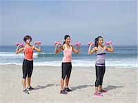 3 women exercising on beach Stock Photo - Premium Royalty-Freenull, Code: 6106-07349805