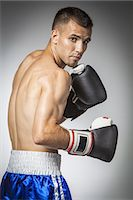 shirtless men - Portrait of male boxer in guard Stock Photo - Premium Royalty-Freenull, Code: 6106-07350389