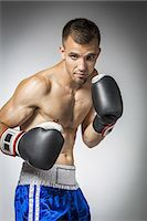 shirtless men - Portrait of male boxer in guard Stock Photo - Premium Royalty-Freenull, Code: 6106-07350390