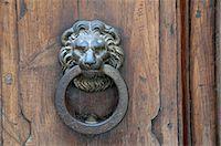 Walled city of San Gimignano door knocker Stock Photo - Premium Royalty-Freenull, Code: 6106-07350463