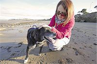 woman training dog on sandy beach Stock Photo - Premium Royalty-Freenull, Code: 6106-07350773