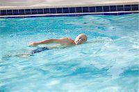 swimming pool water - Fit retired man swimming in pool Stock Photo - Premium Royalty-Freenull, Code: 6106-07350954