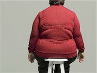 Obese woman on chair Stock Photo - Premium Royalty-Freenull, Code: 6106-07351011