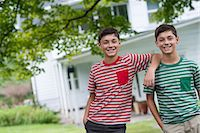 Two boys in a farmhouse garden in summer. Stock Photo - Premium Royalty-Freenull, Code: 6118-07351226
