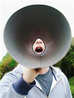 A man using a megaphone in the open air. Stock Photo - Premium Royalty-Freenull, Code: 6118-07351279