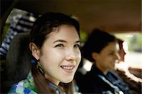 female truck driver - Three passengers in the cab of a pickup truck. One young man driving. Two young women sitting beside him. Stock Photo - Premium Royalty-Freenull, Code: 6118-07351667