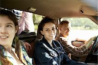 female truck driver - Three passengers in the cab of a pickup truck. One young man driving. Two young women sitting beside him. Stock Photo - Premium Royalty-Freenull, Code: 6118-07351668