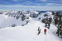 snow capped - A climber in a red jacket on the summit of Snoqualmie Peak in the Cascades range of mountains in Washington state, USA. Stock Photo - Premium Royalty-Freenull, Code: 6118-07351705
