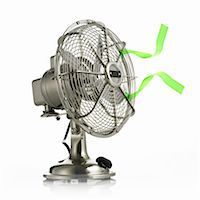 streamer - An electric fan with protective cage around the moving parts, and green streamers waving in the breeze. Stock Photo - Premium Royalty-Freenull, Code: 6118-07351716