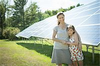 solar panel usa - A child and her mother in the fresh open air, beside solar panels on a sunny day at a farm in New York State, USA. Stock Photo - Premium Royalty-Freenull, Code: 6118-07351950