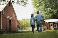 Two people, man and woman in the yard of a traditional farm in the USA. Stock Photo - Premium Royalty-Freenull, Code: 6118-07352011