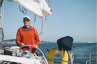 sports and sailing - Middle aged man steering sailboat on Puget Sound, Washington, USA Stock Photo - Premium Royalty-Freenull, Code: 6118-07352546