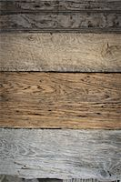 A heap of recycled reclaimed timber planks of wood. Environmentally responsible reclamation in a timber yard. Varieties of wood, with grain and colour details. Stock Photo - Premium Royalty-Freenull, Code: 6118-07353403