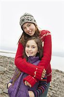 A day out at Ashokan lake. Two girls hugging and looking at the camera. Stock Photo - Premium Royalty-Freenull, Code: 6118-07353565