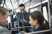 Business people in the city. Three people on the move, two men and a woman, on the bus. Stock Photo - Premium Royalty-Freenull, Code: 6118-07353635