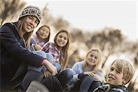 Five children on a farm. Boys and girls in warm jackets outdoors. Stock Photo - Premium Royalty-Freenull, Code: 6118-07353779