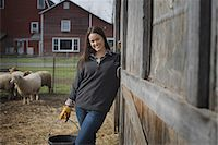 A small organic dairy farm with a mixed herd of cows and goats.  Farmer working and tending to the animals. Stock Photo - Premium Royalty-Freenull, Code: 6118-07353939