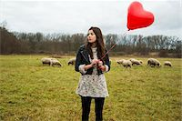 Young Woman with Heart-shaped Balloon by Sheep in Field, Mannheim, Baden-Wurttemberg, Germany Stock Photo - Premium Rights-Managednull, Code: 700-07355335