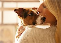 Young Woman Kissing Dog Stock Photo - Premium Rights-Managed, Artist: ableimages, Code: 822-07355457