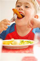 Young Boy Eating Fish fingers and Vegetables Stock Photo - Premium Rights-Managed, Artist: ableimages, Code: 822-07355467