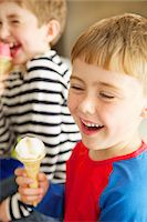 Two Young Boys Eating Ice Cream Stock Photo - Premium Rights-Managednull, Code: 822-07355475