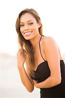Attractive Woman Smiling Outdoors Stock Photo - Premium Rights-Managednull, Code: 822-07355506