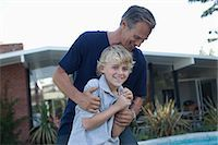 Father and son playing outdoors Stock Photo - Premium Royalty-Freenull, Code: 635-07364209