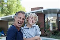 Father and son playing outdoors Stock Photo - Premium Royalty-Freenull, Code: 635-07364212