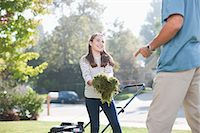 Father and daughter mowing lawn together Stock Photo - Premium Royalty-Freenull, Code: 635-07364236