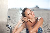 shower - Woman in bikini showering on beach Stock Photo - Premium Royalty-Freenull, Code: 635-07364637