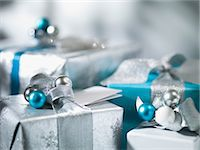 present wrapped close up - Christmas gifts with silver ribbon Stock Photo - Premium Royalty-Freenull, Code: 635-07364823