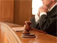Judge and gavel in courtroom Stock Photo - Premium Royalty-Freenull, Code: 635-07365291