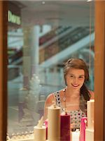 Teenage girl looking at jewelry in display case Stock Photo - Premium Royalty-Freenull, Code: 635-07365305
