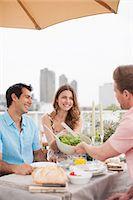 Couples enjoying party on balcony Stock Photo - Premium Royalty-Freenull, Code: 635-07365356