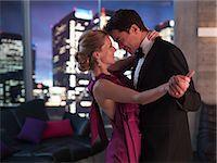 Elegant couple dancing in living room Stock Photo - Premium Royalty-Freenull, Code: 635-07365384