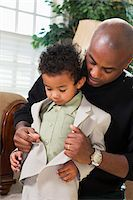 Father Helping Son Button Suit Jacket, Getting Ready for Church Stock Photo - Premium Royalty-Freenull, Code: 600-07368542