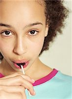 sucking - Girl (10-12) eating lollipop, portrait, close-up Stock Photo - Premium Royalty-Freenull, Code: 618-07370061