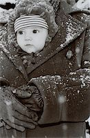 Baby in Adult's Coat Stock Photo - Premium Royalty-Freenull, Code: 618-07376559