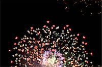 exploding - Fireworks exploding in night sky Stock Photo - Premium Royalty-Freenull, Code: 618-07382018