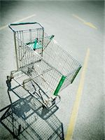 empty shopping cart - Vignette of empty shopping cart in parking lot Stock Photo - Premium Royalty-Freenull, Code: 618-07385028