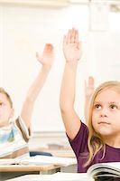 Young Children Raising Hands In Class Stock Photo - Premium Royalty-Freenull, Code: 618-07395091