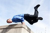 hand stand on a building corner Stock Photo - Premium Royalty-Freenull, Code: 618-07399500
