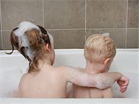 Young girl in tub with baby boy. Stock Photo - Premium Royalty-Freenull, Code: 618-07401255