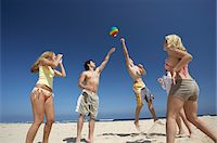 Teenagers Playing with a Ball on a Beach Stock Photo - Premium Royalty-Freenull, Code: 618-07404370